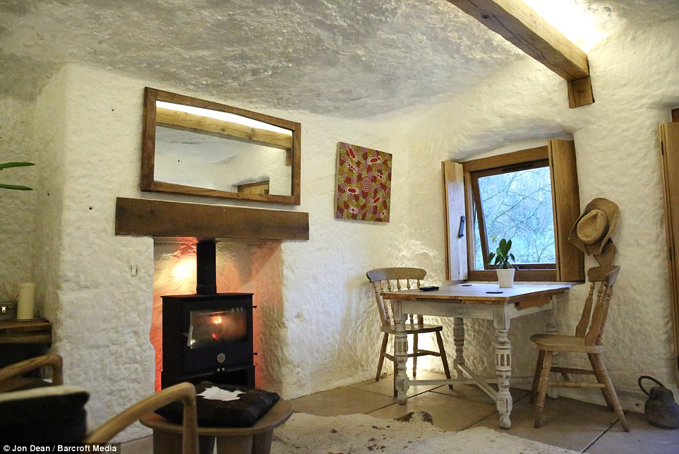 The father-of-two excavated 70 to 80 tonnes of stone by hand before turning his dream into a reality. This is the finished dining room