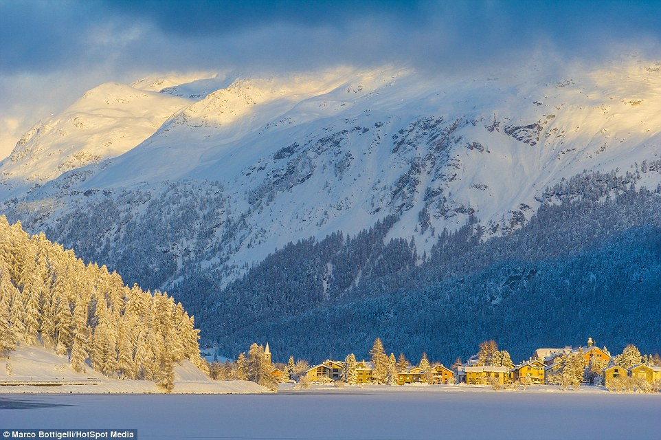 31F2FF0900000578-0-The_sun_shines_a_golden_glow_on_Silvaplana_Switzerland_-a-37_1457355303987