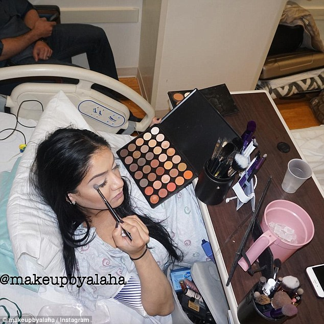 Getting ready: Alongside the jug of ice chips left by nurses for her to eat and stay hydrated, Alaha set up a full make-up station on her hospital bed, applying everything from foundation to false eyelashes