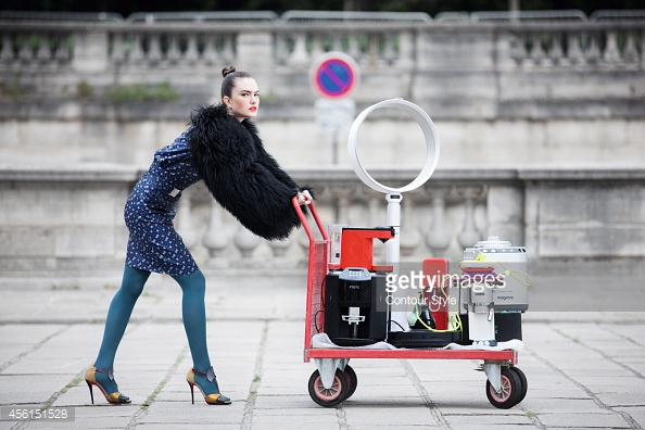 PARIS, FRANCE - JULY 22: FIGARO ID 110525-003 Model poses at a fashion shoot for Madame Figaro on July 22, 2014 in Paris, France. Senseo coffee machine (Philips at Darty). Barista machine (Krups). Fan (Dyson). Iron (Electrolux). Robot vaccum cleaner (Miele). Food scales (Aubecq at Culinarion). Weight (Little Balance). Espresso machine (DeLonghi). Ice cream machine (Magimix). Dress (Jean-Charles de Castelbajac), jacket(Chanel), shoes (Christian Louboutin). PUBLISHED IMAGE. CREDIT MUST READ: Coco Amardeil/Figarophoto/Contour Style. (Photo by Coco Amardeil/Figarophoto/Contour Style by Getty Images)