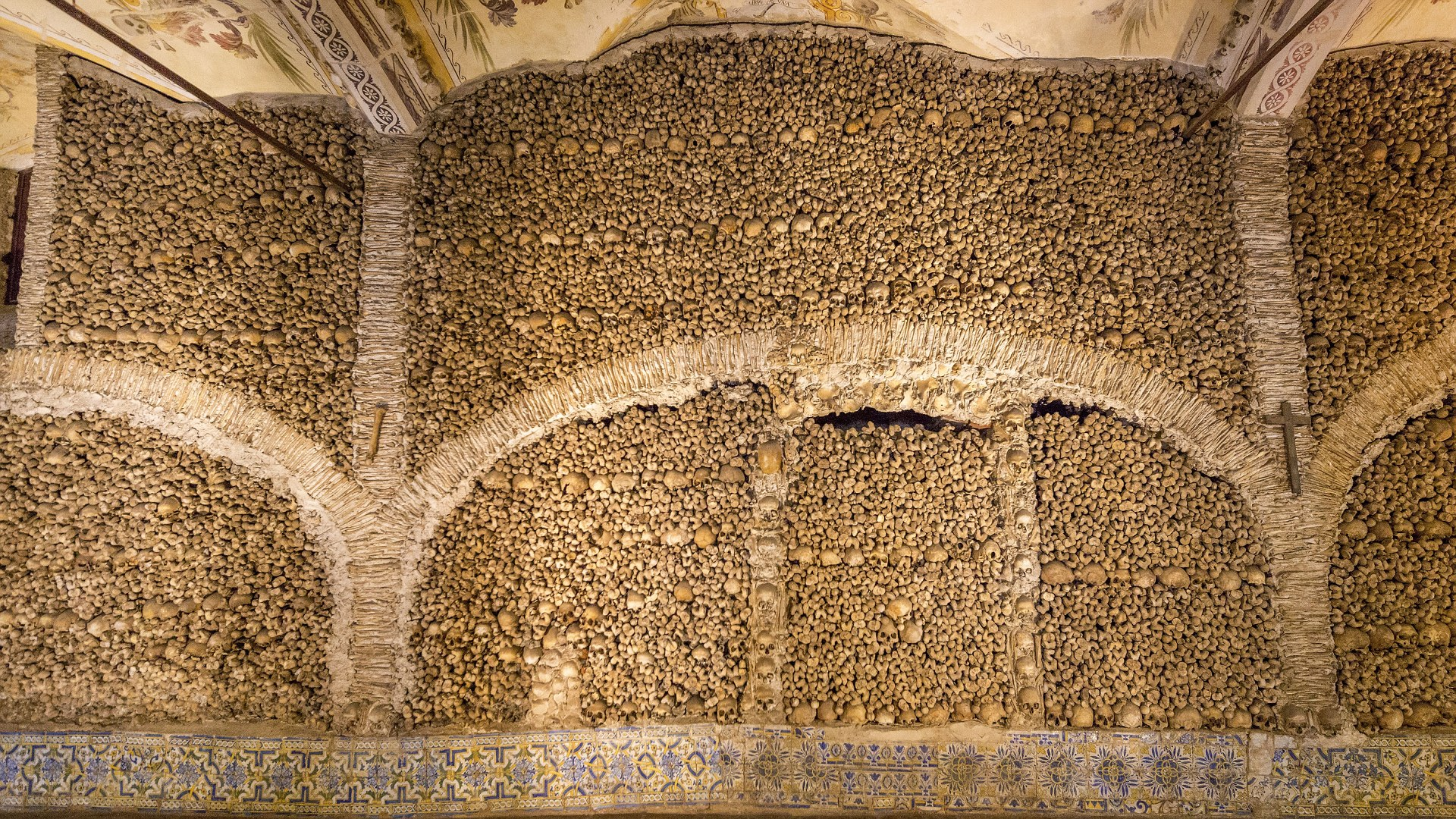 Mandatory Credit: Photo by imageBROKER/REX/Shutterstock (3469099a) Stacked bones and skulls in the ossuary, Capela dos ossos parede, chapel of the bones, bones chapel VARIOUS