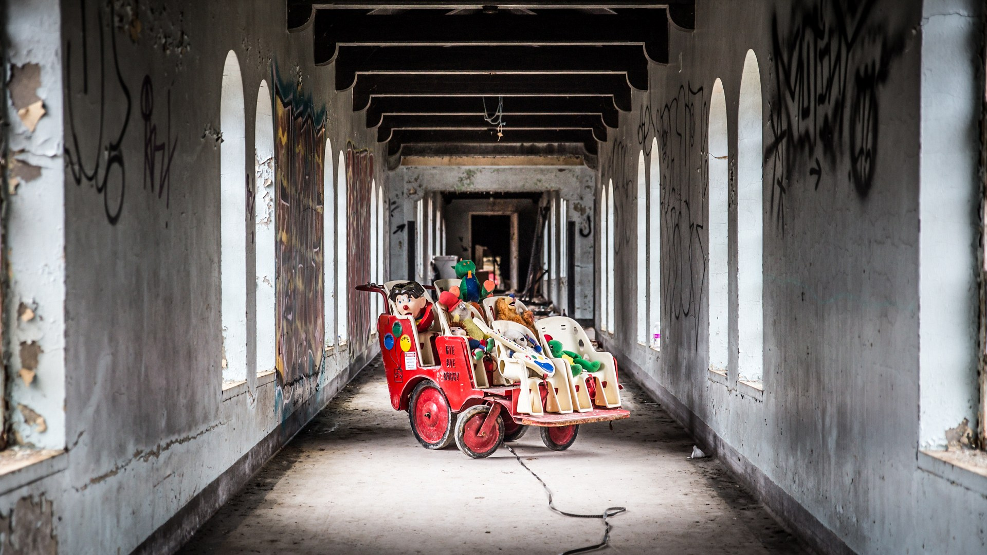 ORANGEBURG, NEW YORK - FEBRUARY 7, 2016: View inside abandoned children's ward at Rockland Psychiatric hospital with eerie toys on cart; Shutterstock ID 400077481