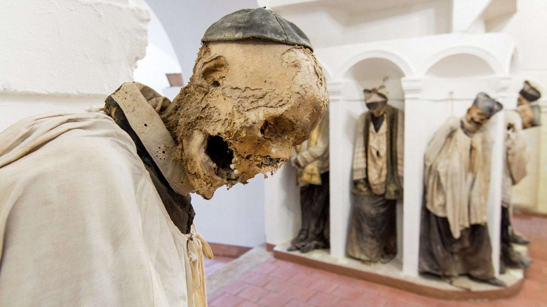 GANGI, ITALY - July 03, 2016: The crypt of the mother church, where all priests are buried mummified. ; Shutterstock ID 456120115
